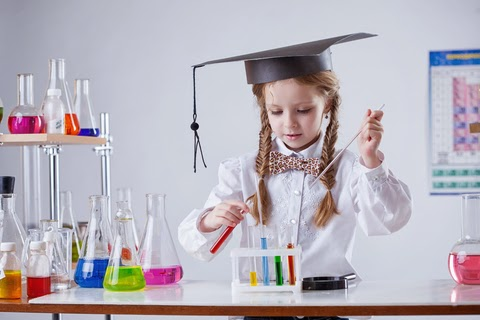 Image of girl mixing tubes in a laboratory