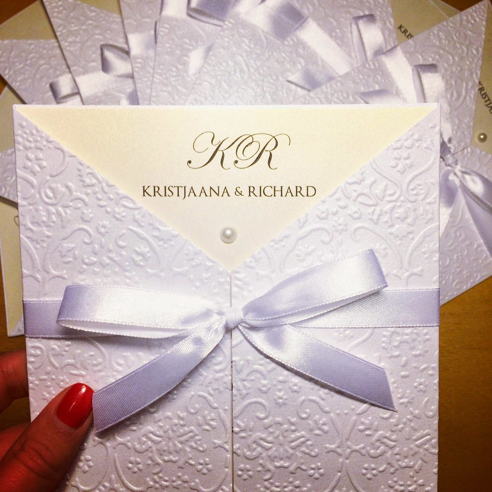 white-gold-wedding-invitations-bow-pearl