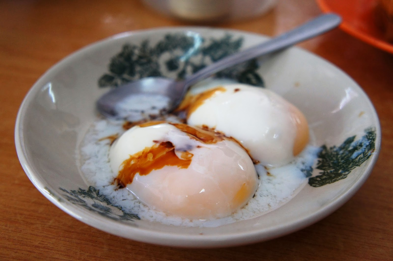 炸弹 (Zhà dàn) pronounced 'Zar tan'  in Hokkien dialect = Half Boiled Eggs