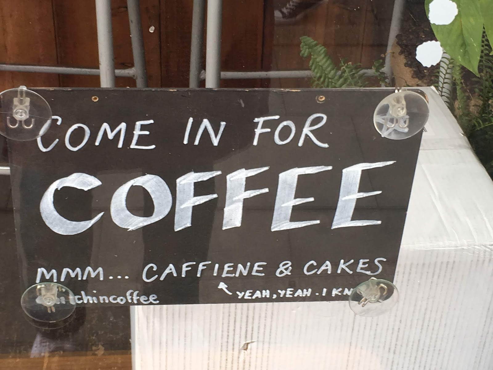 Sign saying come in for coffee