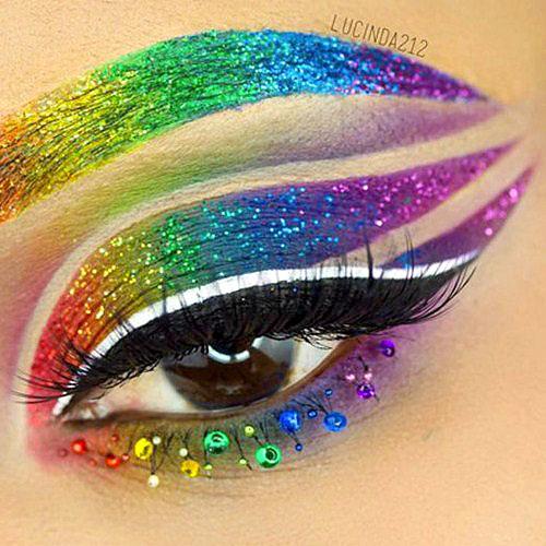 maquillaje arco iris rainbow con glitter, bindis y pestañas postizas