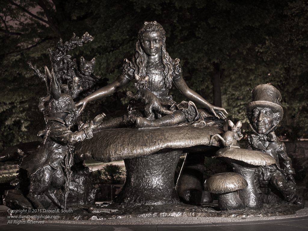 a photo of the alice in wonderland statue in central park