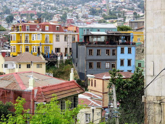 Valparaíso Day Trip from Santiago: colorful yellow building in the distance