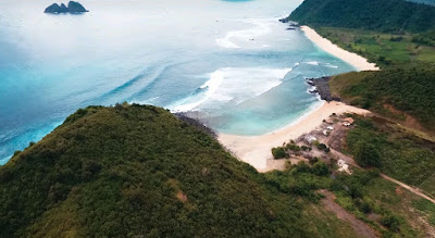 A royalty free of aerial drone shot of Maui Mawi Beach in Lombok
