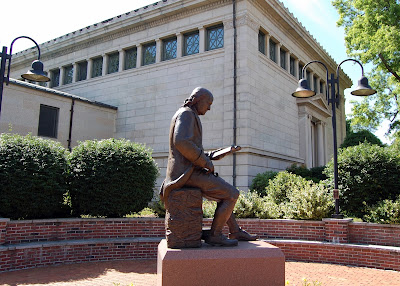 Ben Franklin reads outside the Franklin Public Library. The Library opens Monday, MAy 2 i n its new temporary space while renovations are made to this facility