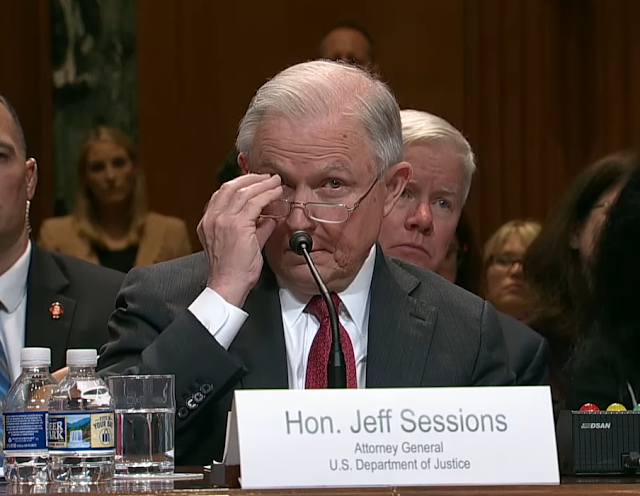 Attorney General Jeff Sessions adjusting his glasses Congressional testimony