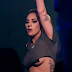 Lady Gaga flashes her under boob as she performs after being hooked up to an IV drip (photos)
