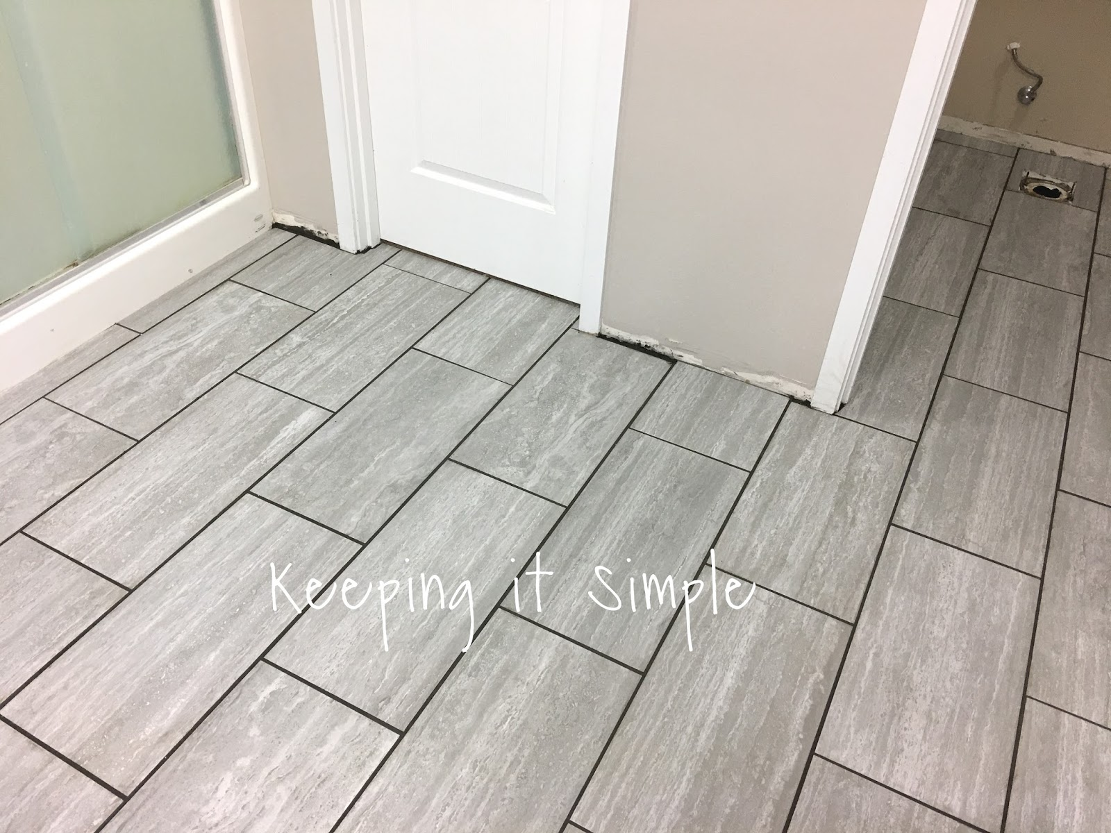 Tips on how to install tile flooring in a bathroom with ridgemont once the grout had set for about 36 hours we sealed the grout lines and then we put the toilet back on we ended up getting a new toilet dailygadgetfo Images