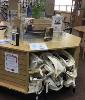 Book Club collection - bagged and on display for patrons