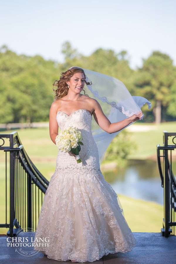 Image of a bride on the spiral staircase at River Landing - River Landing Weddings