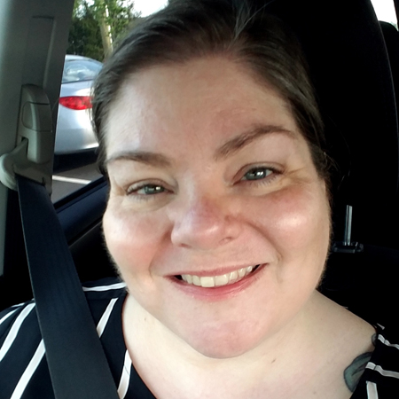 image of me from the shoulders up, in the car, with my hair pulled back, wearing my contacts and a black and white striped blouse