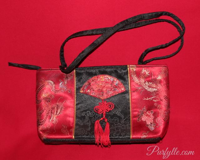 a pretty, but broken, handbag - it's just clutter
