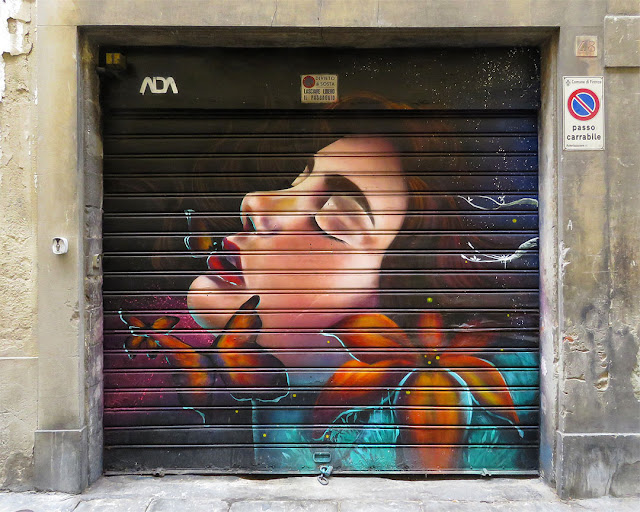 Mural on a rolling shutter, Via dei Pandolfini 48 red, Florence
