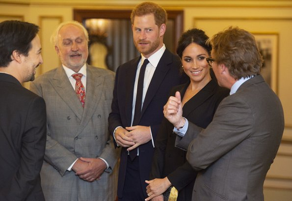 Meghan Markle wore Judith & Charles Digital Dress, Paul Andrew pumps, carried Jimmy Choo clutch. Prince Harry