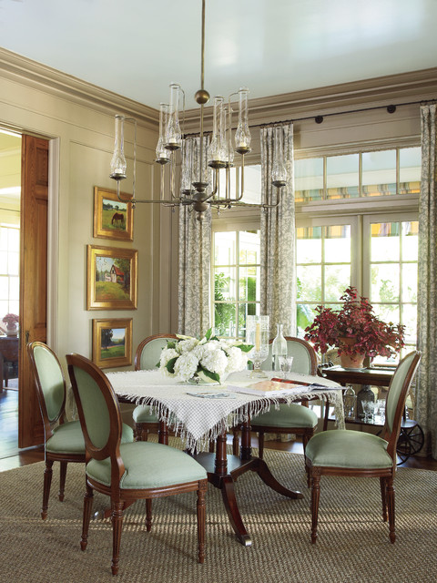 Small Wooden Dining Room Tables And Chairs on the Brown Carpet under the Wide Iron Chandelier