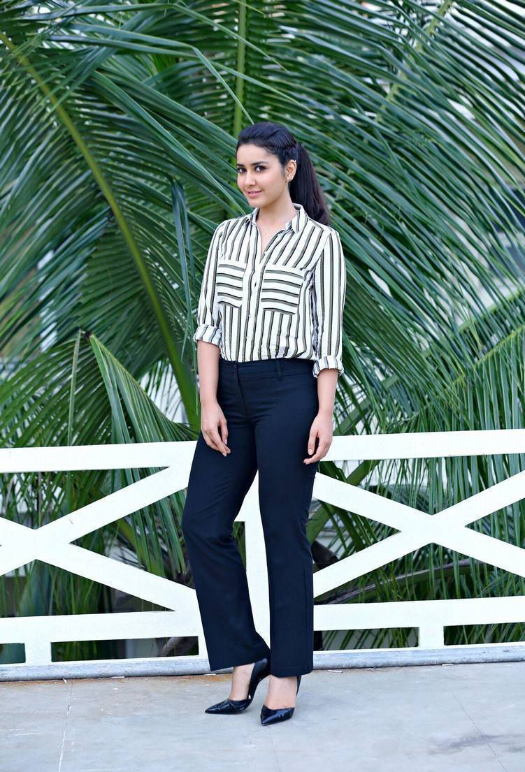 Rashi Khanna Photo shoot In White Shirt Blue Pant
