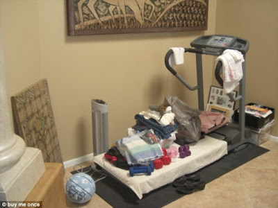 treadmill out of use with clothes on it