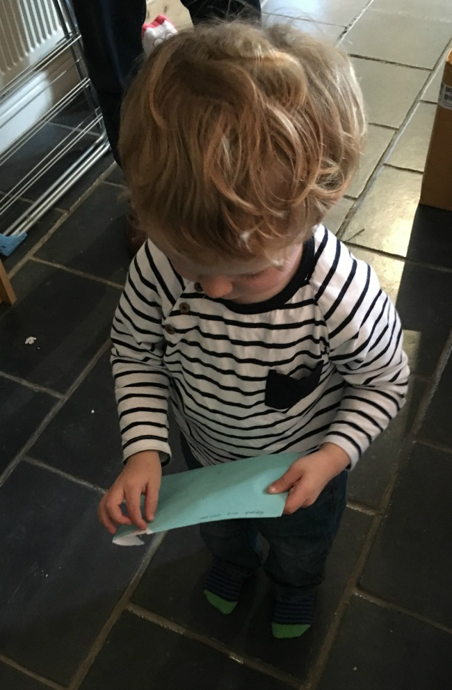 toddler-opening-envelope