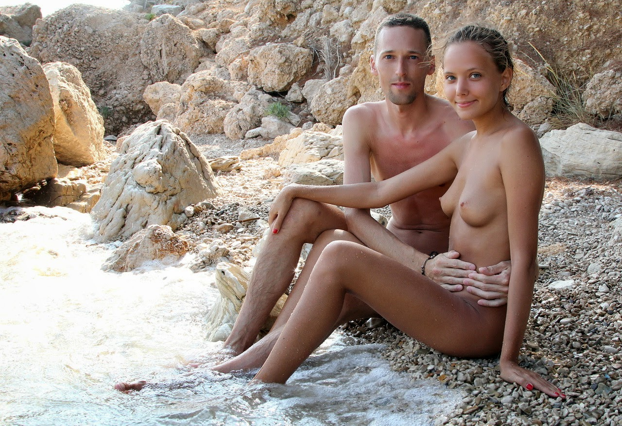 NUDIST FAMILY AT NUDE BEACH