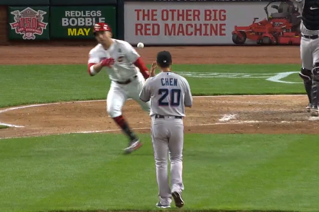 Joey Votto tosses ball back to pitcher