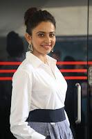 Rakul Preet Singh looks super cute in White Shirt and Skirt at Jaya Janaki Nayaka press meet 10.08.2017 015.JPG