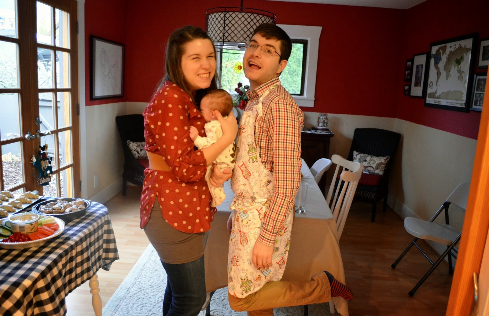 new parents with their new baby at thanksgiving