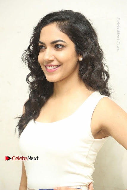 Actress Ritu Varma Stills in White Floral Short Dress at Kesava Movie Success Meet .COM 0001.JPG