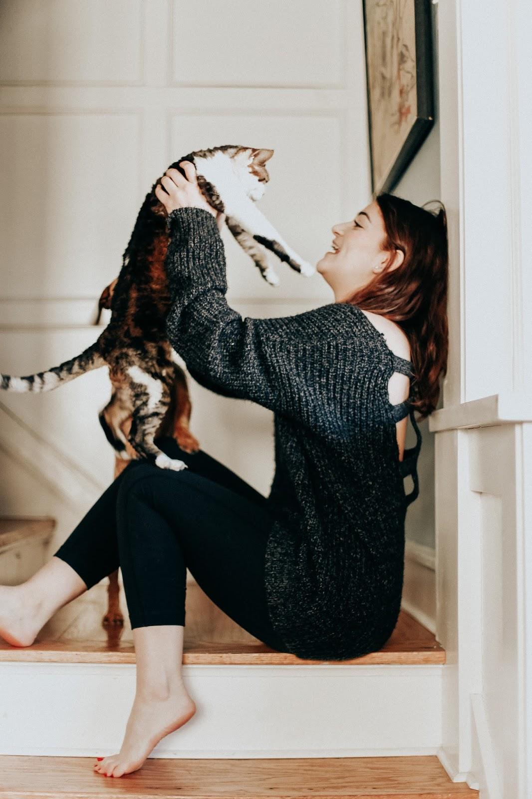model holding cat by zoe alexandriah
