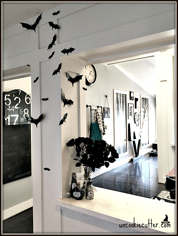 hallway dressed for halloween with bats on the wall. Grey walls and dark floors