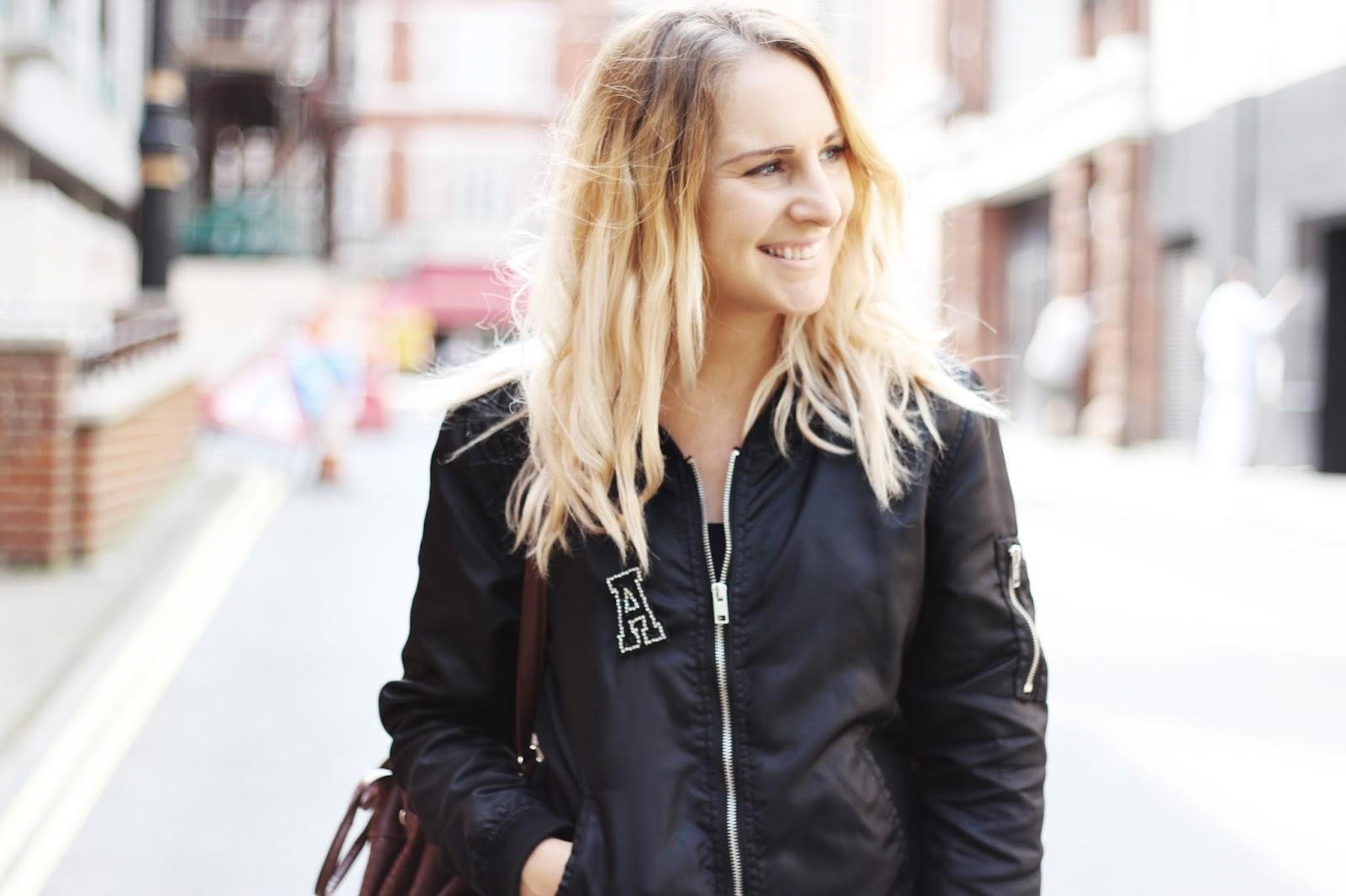 bomber jacket and midi skirt street style