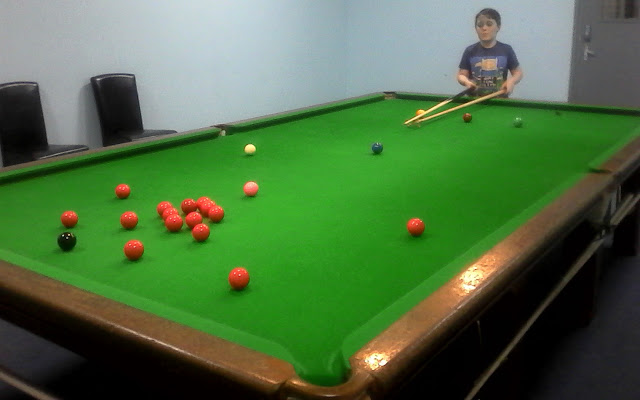 A boy at a snooker table