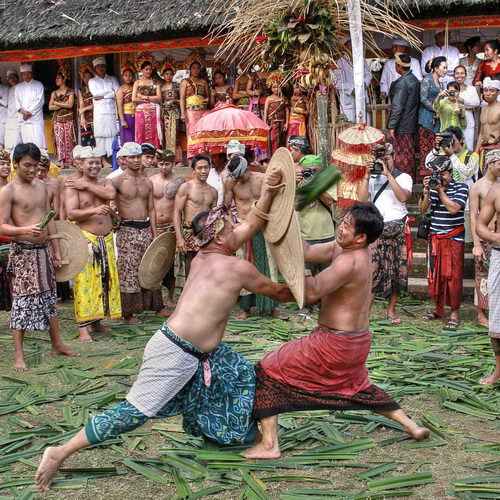 Tinuku Travel Tenganan village genuine Balinese traditional culture in scene, pandanus war and woven fabric Gringsing