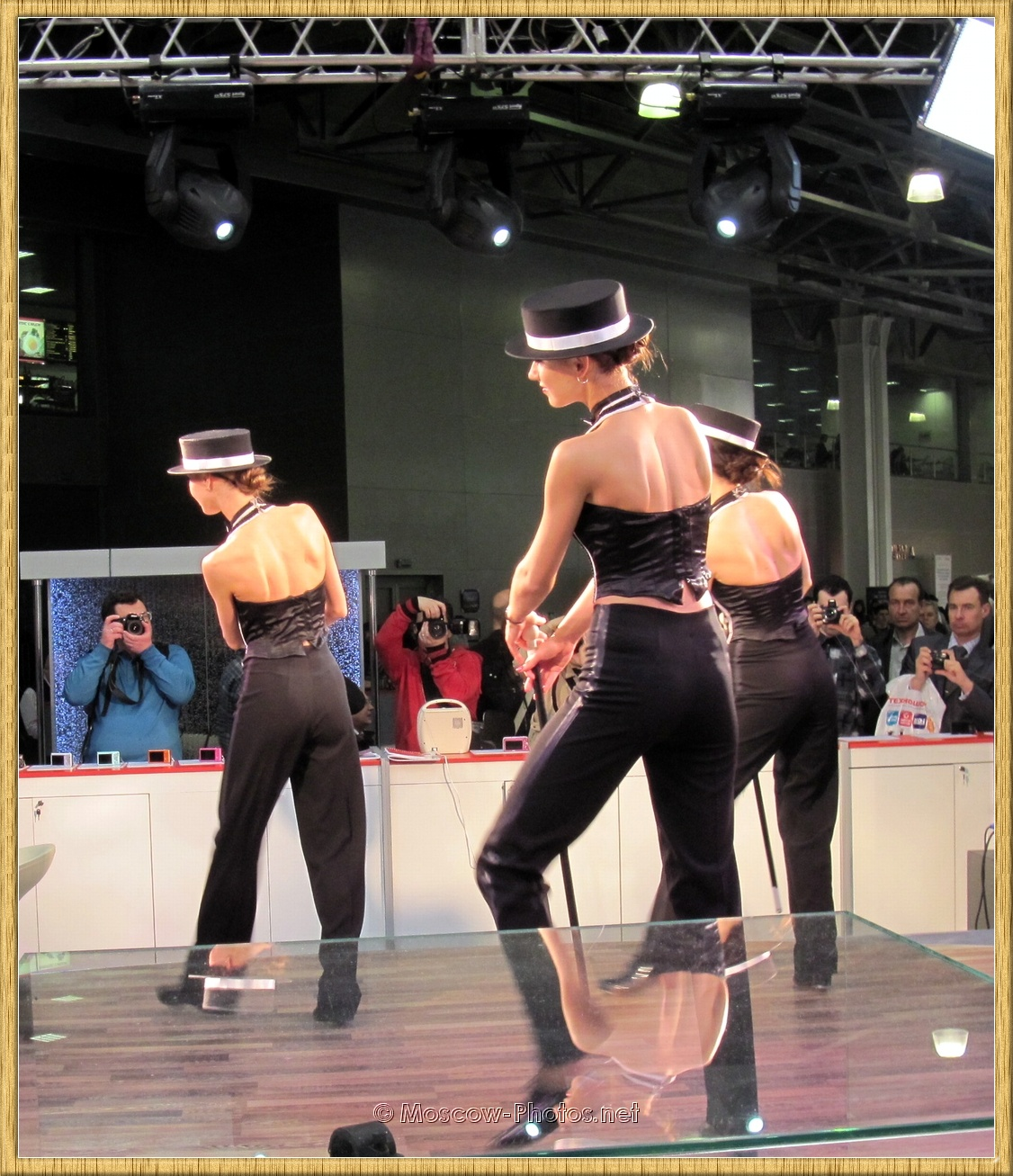 Girls dancing in black trouser suits