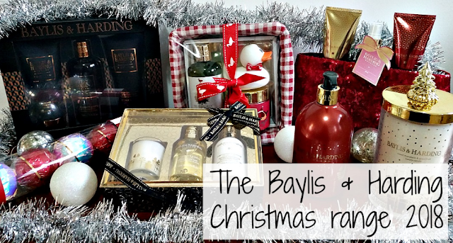 a selection of the baylis and harding xmas range surrounded by baubles and tinsel