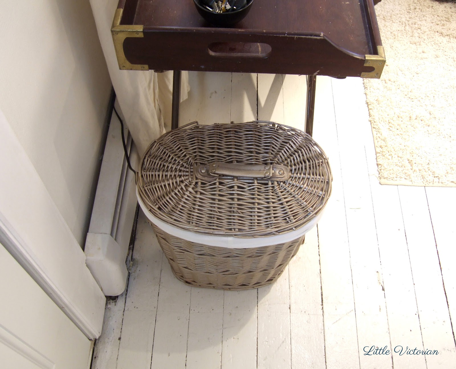 Painted wicker basket to hide paper shredder at front door | Little Victorian
