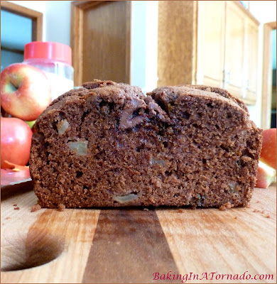 Caramel Topped Apple Spice Bread, a quick bread filled with fall flavors, chopped apples and spices. Topped with caramel filled chocolates | Recipe developed by www.BakingInATornado.com | #recipe #bake