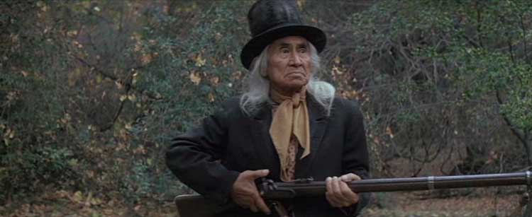 Lone Watie pulls out a shotgun in The Outlaw Josey Wales.