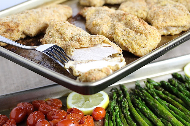 SHEET PAN PARMESAN CHICKEN WITH ASPARAGUS AND TOMATOES