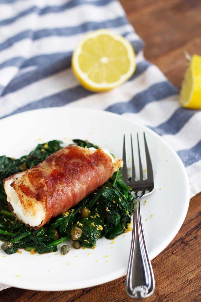 Prosciutto-Warappad Cod With Lemon Caper Spinach