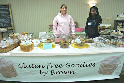 Angie Brown working at her Gluten Free Goodies By Brown table at the Lansing Gluten Free Fair.