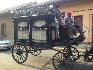 Ox drawn carts and horse drawn hearses