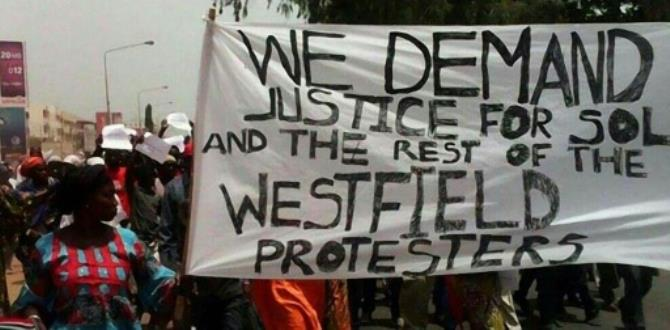 People demonstrate in Banjul following the death in custody of a senior figure in Gambia's main opposition)