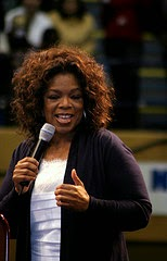 Oprah Winfrey with microphone in hand