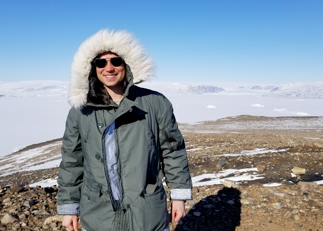 Young man in cold weather gear on barren terrain