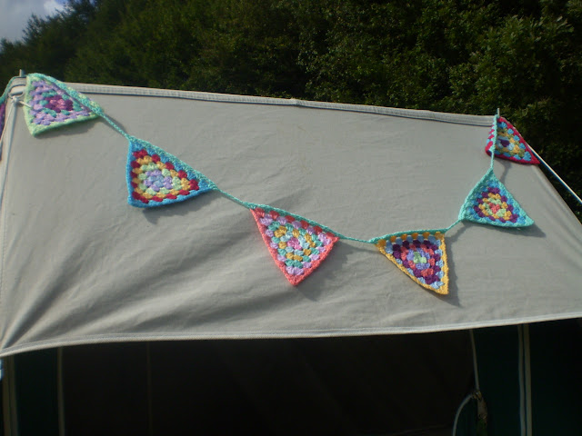 crochet bunting decorating a canvas tent