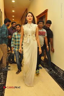 Actress Pragya Jaiswal Stills in Beautiful White Dress at turodu Audio Launch  0074.JPG