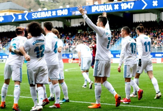 Real Madrid players celebrating a goal