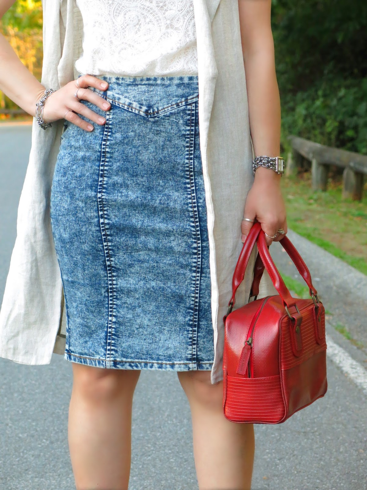 acid-wash denim pencil skirt, lacy top, sleeveless linen coat, and box bag