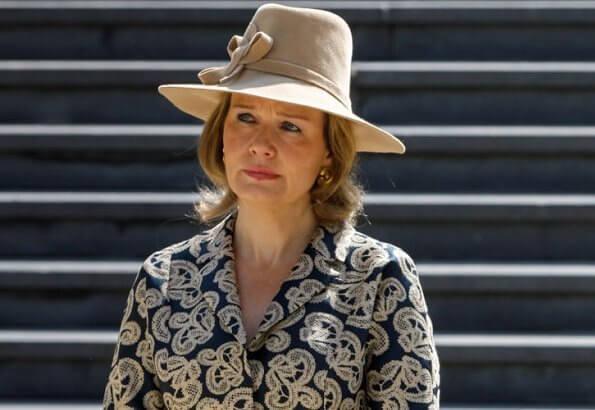 Prime Minister Sophie Wilmes. Queen wore a patterned coatdress by Armani, Natan, Dries Van Noten, Diane Von Furstenberg