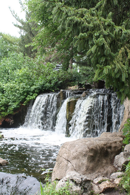 A man made waterfall at Lake Katherine provides a scenic backdrop
